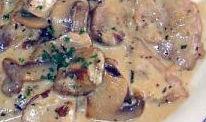 Scaloppine con funghi e prosciutto